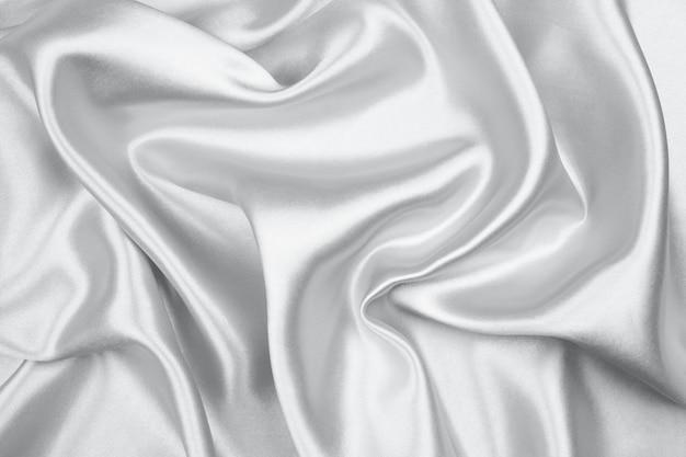 抽象的な背景のシルバーシルクテクスチャ豪華なサテン