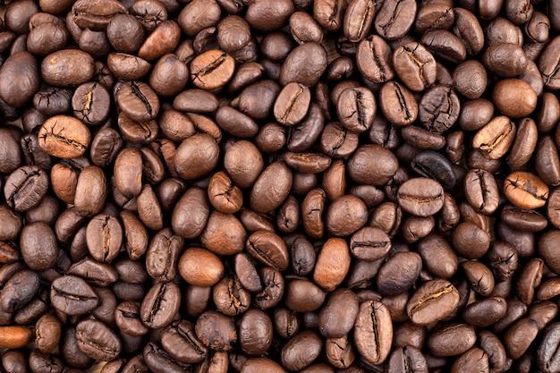 Текстура жареного кофе в качестве фона