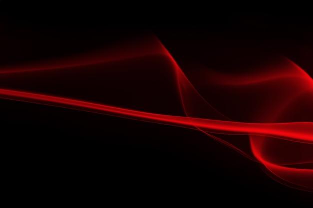 黒い背景に赤い煙の抽象。
