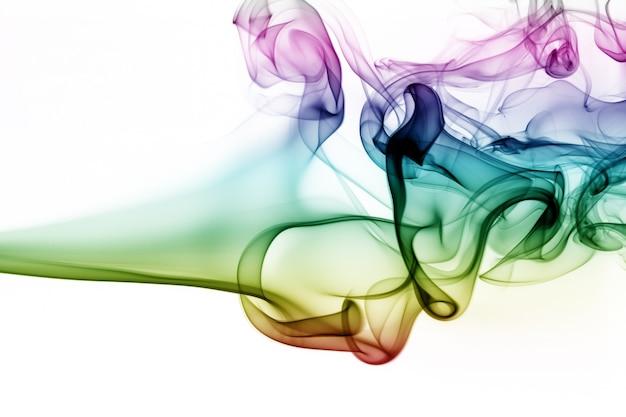 白い背景に抽象的なカラフルな煙。火の設計