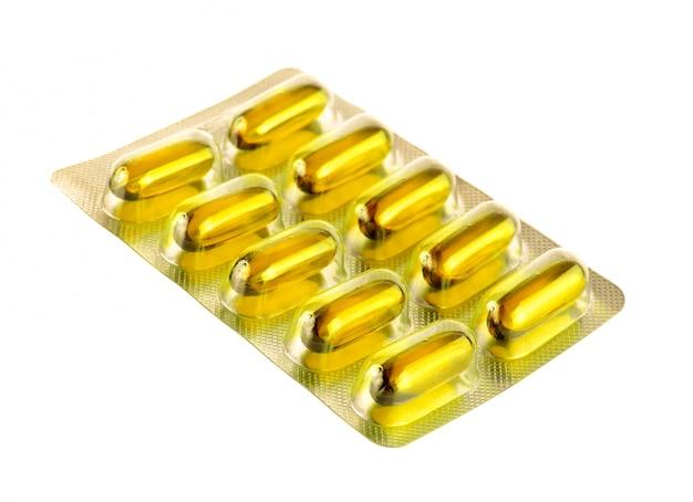Пакеты таблеток на белом фоне