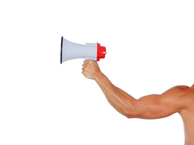 メガホン付きの筋肉の腕