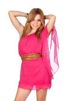 上の白いバックグラウンドで分離したピンクのドレスでファッションの女の子