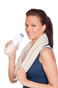 白い背景にはタオルを持つ体操の女の子