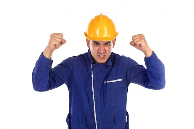 黄色いヘルメットと怒っている労働者