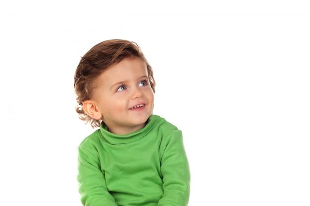 Красивый маленький ребенок двух лет носить зеленый свитер