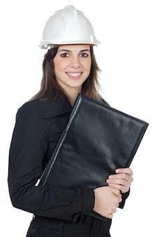 白い背景の上に魅力的な若いエンジニア
