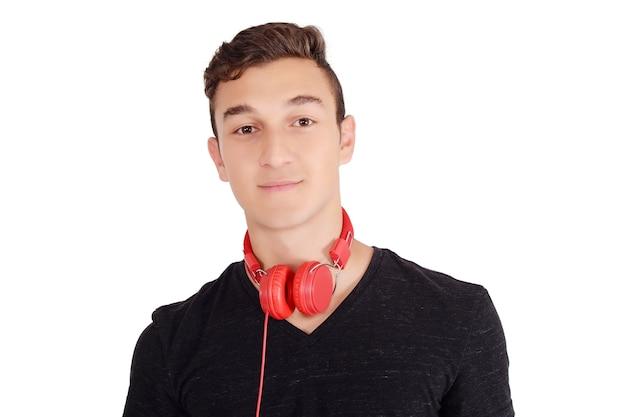 ヘッドフォンで笑顔の十代の耳を傾ける音楽の肖像画