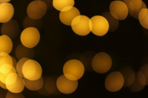 ゴールデンボケ抽象的な光、オレンジ色の背景