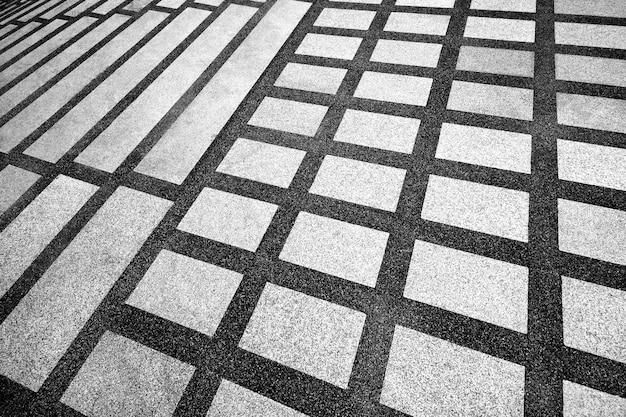 背景の廊下の模様入りの床。