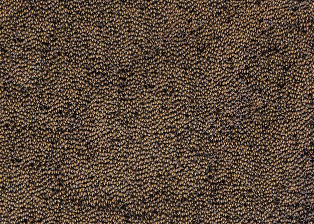 背景に蜂のカラフルな模様の表面。