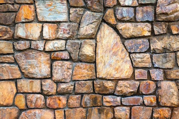 石の壁のカラフルなパターンとテクスチャ。