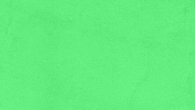 緑の紙テクスチャ背景をクローズアップ