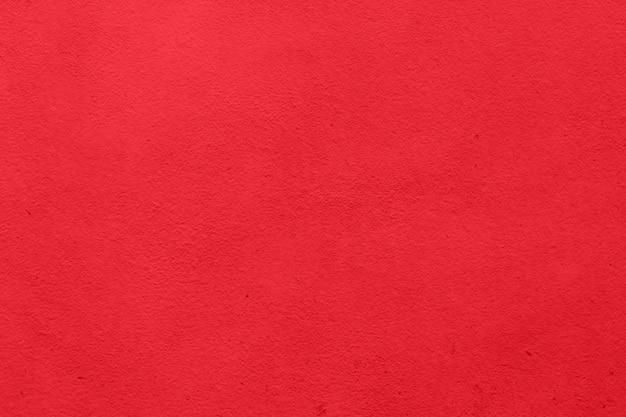 Закройте вверх по красной предпосылке текстуры бумаги