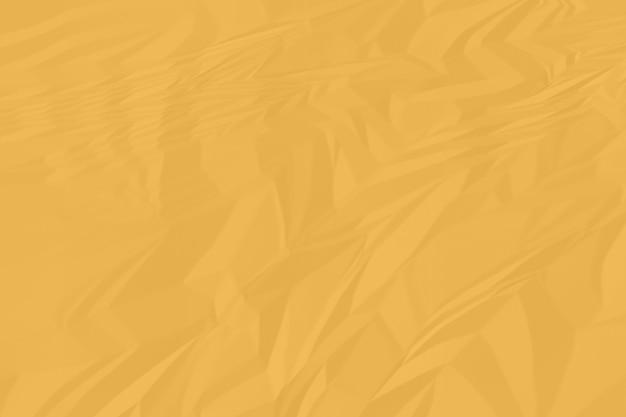 しわくちゃのオレンジ色の紙の背景をクローズアップ