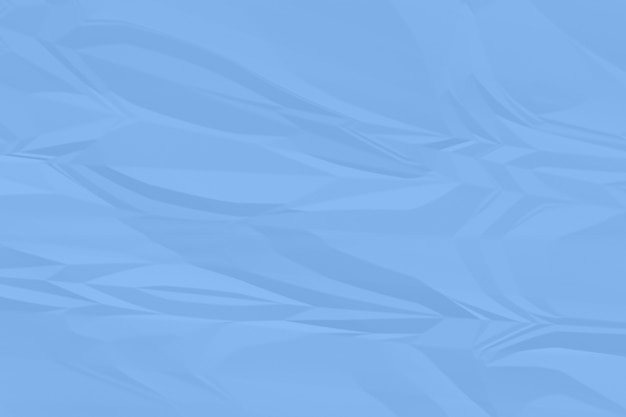 しわくちゃの青い紙の背景をクローズアップ
