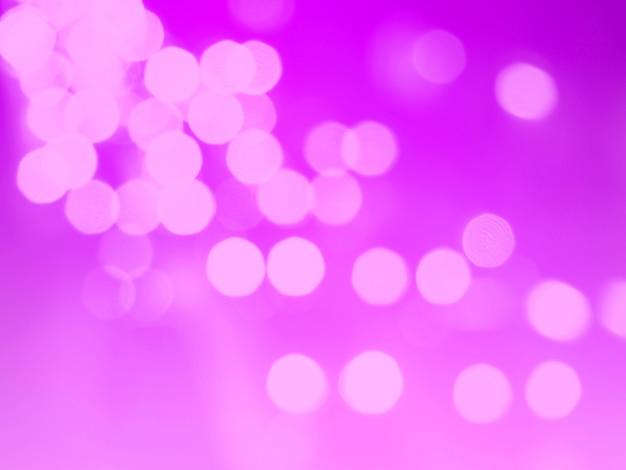 ピンクのボケ味の抽象的な光の背景