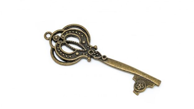 Старинный ключ на белом