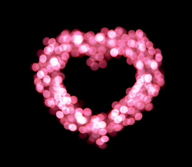ピンクのボケ味ハート形の背景。
