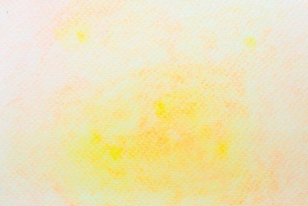 紙の上の抽象的な黄色とオレンジ色の水彩画