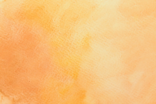 グラデーションの茶色、オレンジ、黄色の水彩画。