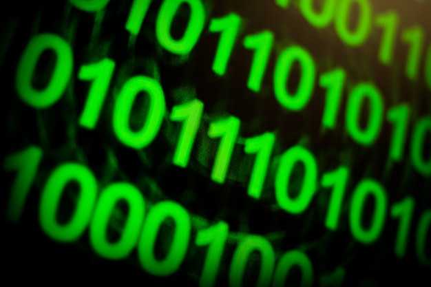 Двоичный язык монитора компьютера цифры зеленый