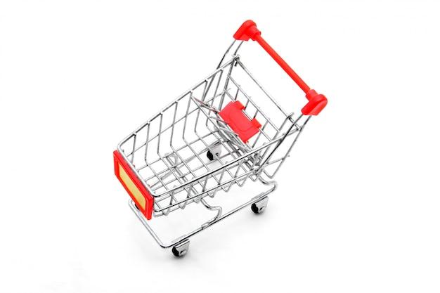 白い背景の上の視点で分離された空っぽのショッピングカート