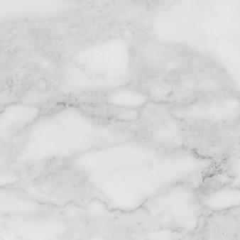 白い大理石の質感の抽象的なパターンの背景