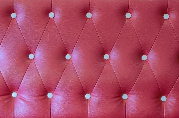 赤い革張りのソファの背景