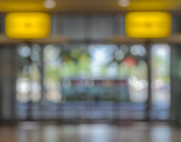 オフィス、空港、病院、ショッピングモールの建物のドアの背景のイメージがぼやけ