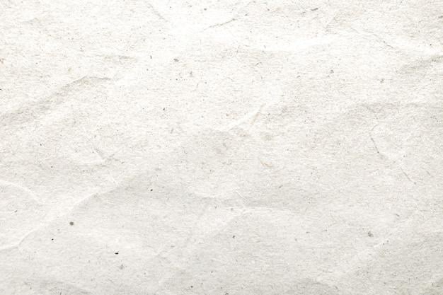 白い紙を丸めてパターンとテクスチャ背景。