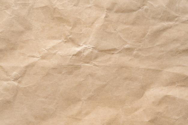 茶色のしわリサイクル用紙の背景。クラフト紙の質感。