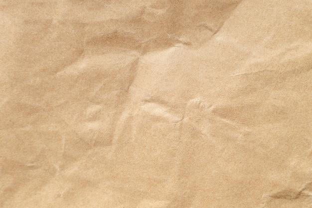 背景の茶色のしわくちゃの紙のテクスチャです。
