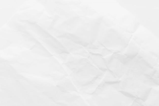白い紙を丸めて、テクスチャ背景。閉じる。