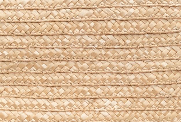 背景として使用するための枝編み細工品バスケットテクスチャを閉じます。編まれたバスケットの質感。