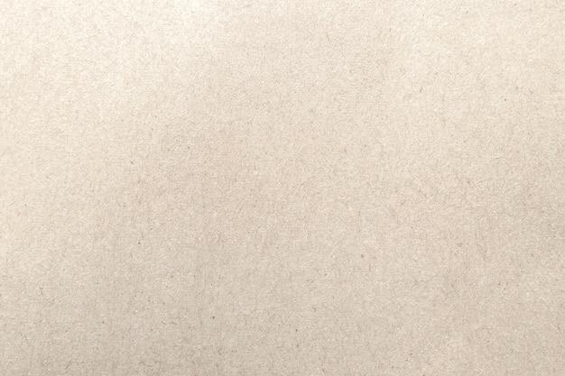 Текстура коричневой бумаги для предпосылки.