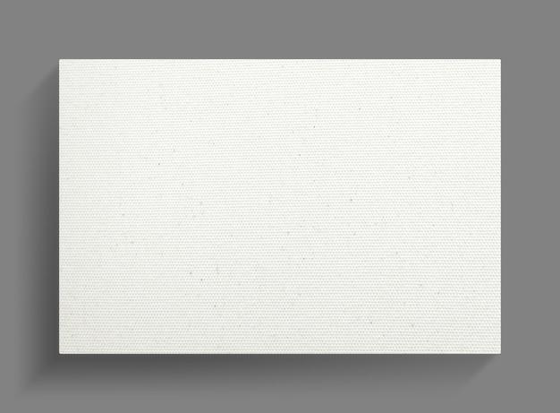 灰色の壁の背景に白のキャンバスフレーム。
