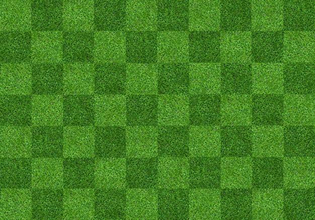 サッカーとフットボールのスポーツのための緑の芝生フィールドの背景