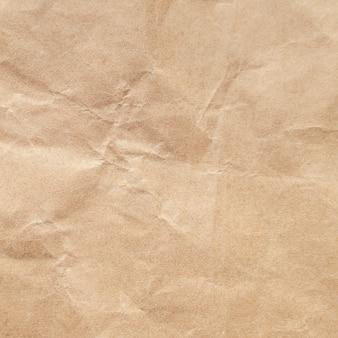 茶色のしわくちゃの紙のテクスチャ背景。