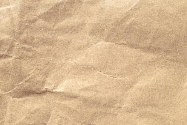 茶色のしわくちゃの紙のテクスチャの背景。