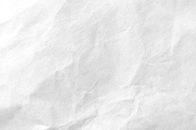 白い紙を丸めてテクスチャ背景。閉じる。