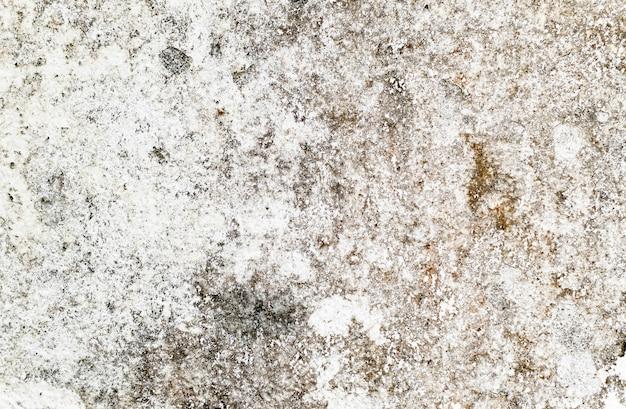 汚れたパターンはセメント表面で覆われています。
