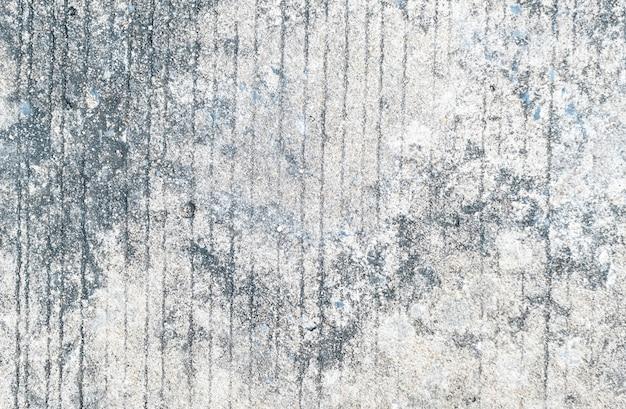 汚れたパターンはセメント表面の背景で覆われています。