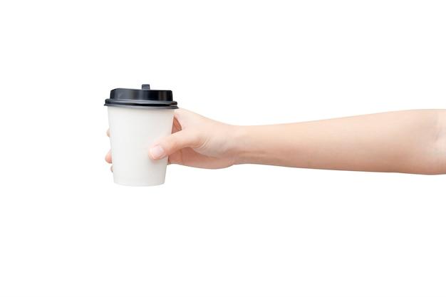 白のコーヒー紙コップを持っている女性の手