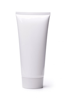 Пустая белая косметическая трубка изолированная на белой предпосылке.