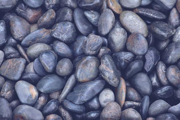 丸い石の背景。ヴィンテージの表情