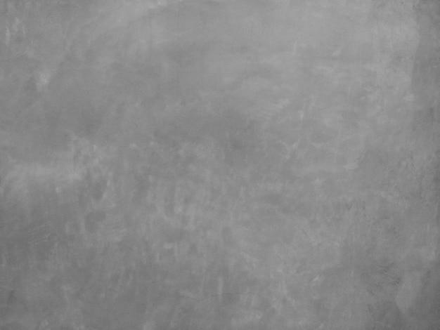 テキスト用の空き容量を持つ灰色のセメント壁の背景。