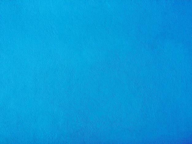 テキスト用の空き容量と青いセメント壁の背景。