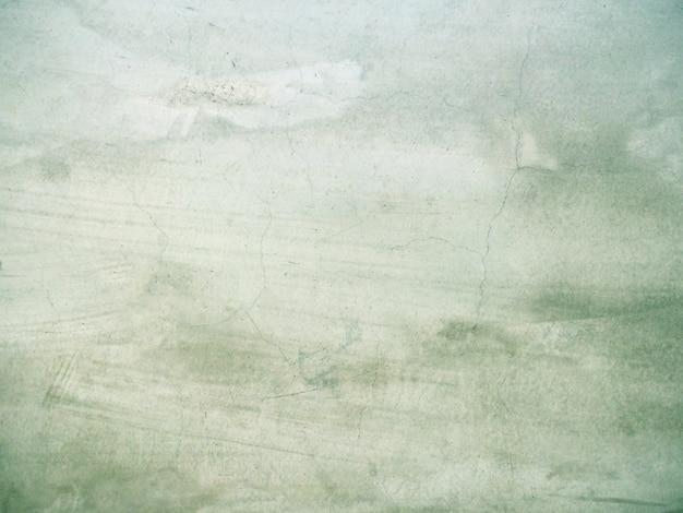 テキスト用の空き容量と緑のセメント壁の背景。