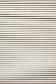 スチールシャイニーローリングシャッタードアのテクスチャ、水平線。